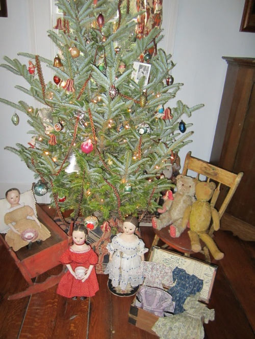 Waiting under the Christmas tree are some of my hand made reproduction Izannah Walker dolls and a pair of antique bears.