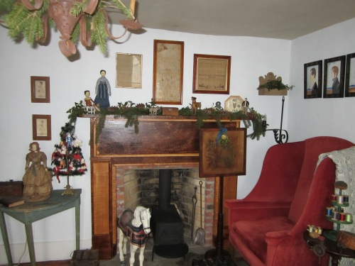 The fireplace in the parlor was added by previous owners.  I grain painted the mantle and surround.  Brian gave me the antique Shaker box stove as a present one Christmas.  A tiny child size metal carousel horse patiently waits along side the stove...