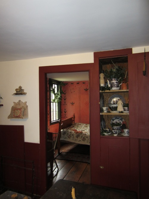 Aview from the 1790's kitchen into the main floor bedchamber.