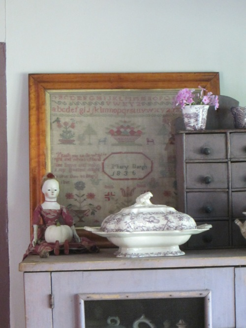 I feel very fortunate to have found a handful of antique samplers stitched in purples, lavenders, rose, pink and mauves.  This is the third one that resides in my kitchen.  The fourth hangs above a very early R.I. blanket chest in my bedroom.